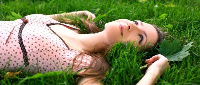 Girl lying on grass and enjoy the life